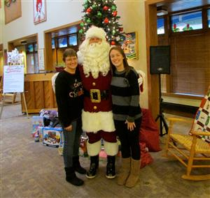 "Ronald McDonald House: (left to right) Mom, ""Santa"" (Dad), and myself"